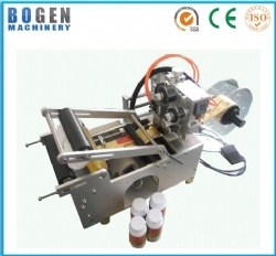 Semi-automatic round bottle labeling and coding machine